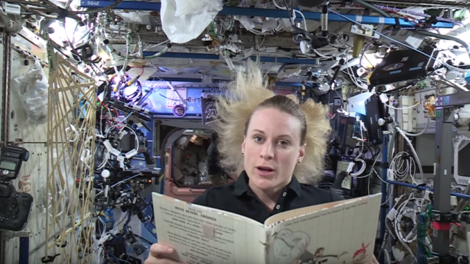 Astronauts reading in space